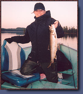 This is a woman holding a nice four pound lake trout